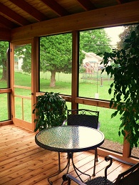 Screen Porch Addition allowing enjoyment of the outside without mosquitos