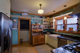 Remodeled kitchen incorporating antiques